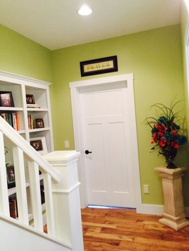 Colorful stairway with built in bookcase.